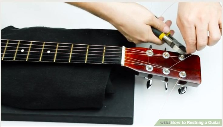 10 easy steps on how to restring an acoustic guitar. Black Bedroom Furniture Sets. Home Design Ideas